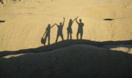 Shadows of people on sand