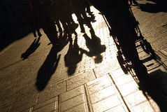 Shadows of people on street. Shadows of people walking on the city street Stock Image