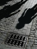 Shadows of people on street Royalty Free Stock Photography