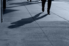 Shadows of People Walking. Shadows and feet of people walking along public sidewalk, San Francisco, California Stock Photography