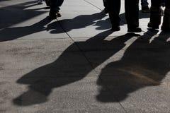 Shadows of People Walking. Shadows and feet of people walking along public sidewalk, San Francisco, California Stock Photo