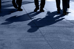 Shadows of People Walking Stock Photography