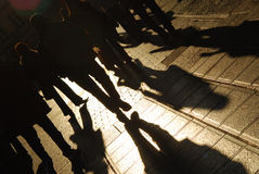 Shadows of people walking