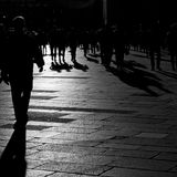 Shadows of people walking in the city. Shadows of people walking in an open square in the city center Stock Images