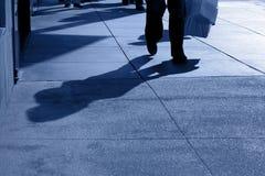 Shadows of People Walking. Shadows and feet of people walking along public sidewalk, San Francisco, California Stock Images