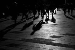 Shadows of people walking in the city. Shadows of people walking in an open square in the city center Stock Image