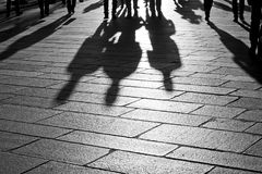 Shadows of people walking in the city. Shadows of people walking in an open square in the city center Royalty Free Stock Photography