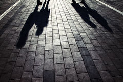 Shadows of people. Walking and stand in a city street Stock Photos