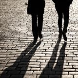 Shadows of people walking in a street Royalty Free Stock Photos