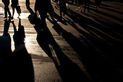 Shadows of people walking street Royalty Free Stock Image