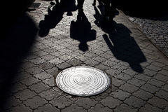 Shadows of people walking street i Royalty Free Stock Images