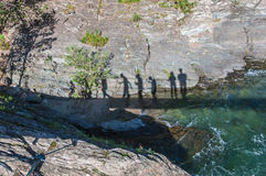 Shadows people walking suspension bridge. Shadows of people crossing the river on a suspension bridge in the mountains Royalty Free Stock Photography