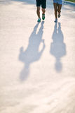 Shadows of runners Royalty Free Stock Images