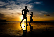 Shadows running at sunset Stock Photography