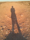 Shadows on a sand road steppe Royalty Free Stock Image