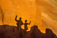 Shadows. Shadow of two people on the rock Royalty Free Stock Photos