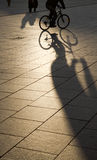 Shadows and silhouettes. Evening shadows and silhouettes in the square Stock Photography