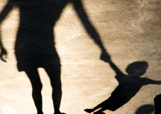 Shadows silhouettes of mother and child on summer promenade stock images