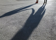 Shadows of skaters on asphalt Royalty Free Stock Photos