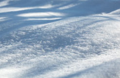 Shadows on the snowfield Royalty Free Stock Photo