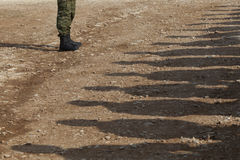 Shadows of soldiers Royalty Free Stock Images