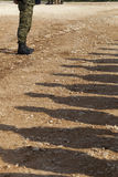Shadows of soldiers Stock Photos