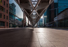 Shadows and Stockings v1. The financial District of Beatrixkwartier in The Hague, The Netherlands. Modern tall buildings surround the futuristic architecture of Royalty Free Stock Image