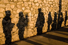 Shadows on the stone. Wall cast by random people Royalty Free Stock Photos