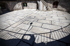 Shadows on stone floor of medieval castle ruins Stock Photo