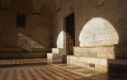 Shadows and stone. Rich lighting with shadows in an Italian church Royalty Free Stock Images