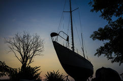 Shadows at sunset the ship and trees Royalty Free Stock Images