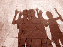 Shadows of three people Royalty Free Stock Image