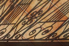 Shadows on tiled patio Stock Photos