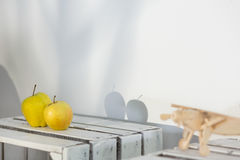 Shadows of two apples on wall Stock Photography