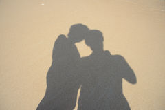 Shadows two people on beach. In Thailand Royalty Free Stock Photography