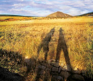 Shadows under hill. Shadows of two figures, sunset in czech mountains Stock Images