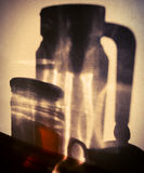 Shadows on the wall of the glassware Stock Photos