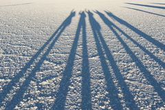 Shadows in the world`s largest salt flat, Salar de Uyuni in Bolivia, photographed at sunrise Stock Photography