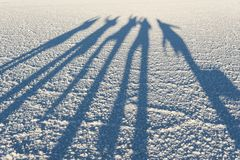 Shadows in the world`s largest salt flat, Salar de Uyuni in Bolivia, photographed at sunrise Stock Photo