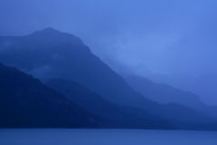 Shadowy blue ridges on overcast day. Shadowy gray green ridges on overcast day,Martinez Fjord, Patagonia Stock Photo