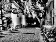 Shadowy courtyard. Infrared shot of courtyard with light and shadows reflecting off surfaces Royalty Free Stock Photo