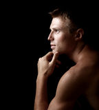 Shadowy dark close-up portrait. Of young good looking male model Stock Photo