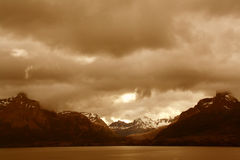 Shadowy sepia ridges. On overcast day, Martinez Fjord, Patagonia, Chile royalty free stock images