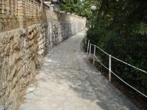 Shadowy walkway on a sunny day - Istria, Croatia Stock Image