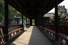 Shady aged Chinese gallery on sunny day Royalty Free Stock Photo