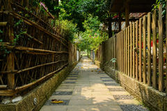 Shady alley between fenced Chinese traditional dwelling building Stock Photo
