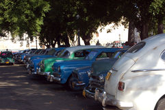 Shady car park, Havana. Cars used as service taxis parked in the shade in Central Havana, Cuba.  There are many vintage 1950's cars still in use in Cuba Stock Image