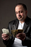Shady Cash Earnings Stock Photography