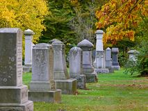Shady cemetery in fall Stock Photography