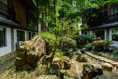 Shady flagstone path between Chinese traditional buildings in su Stock Images